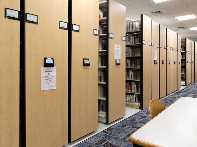 Low-profile compact library shelving